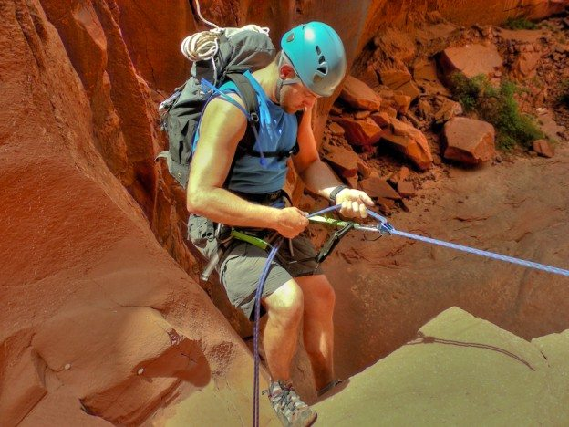 Canyoneer begins 70 foot rappel