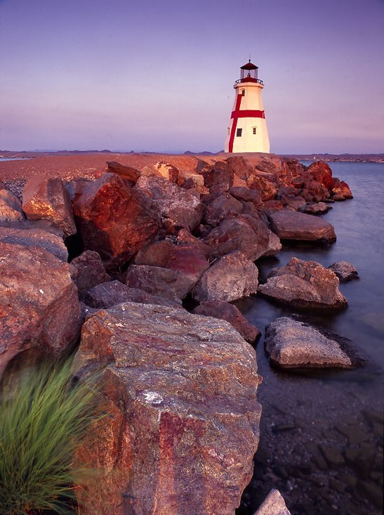 East Quoddy Lighthouse - Looking across rocks towards a replica lighthouse during sunrise