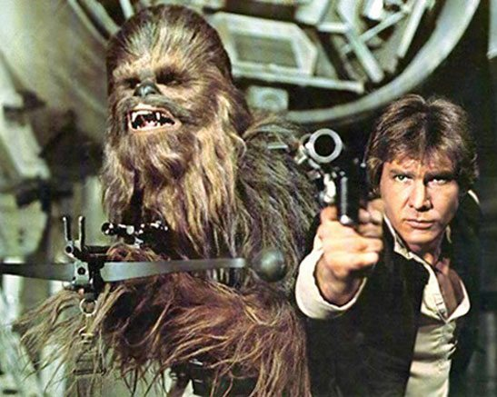 Chewbacca and Han Solo aiming blasters at the viewer - Star Wars Episode IV: A New Hope 1977 Yuma