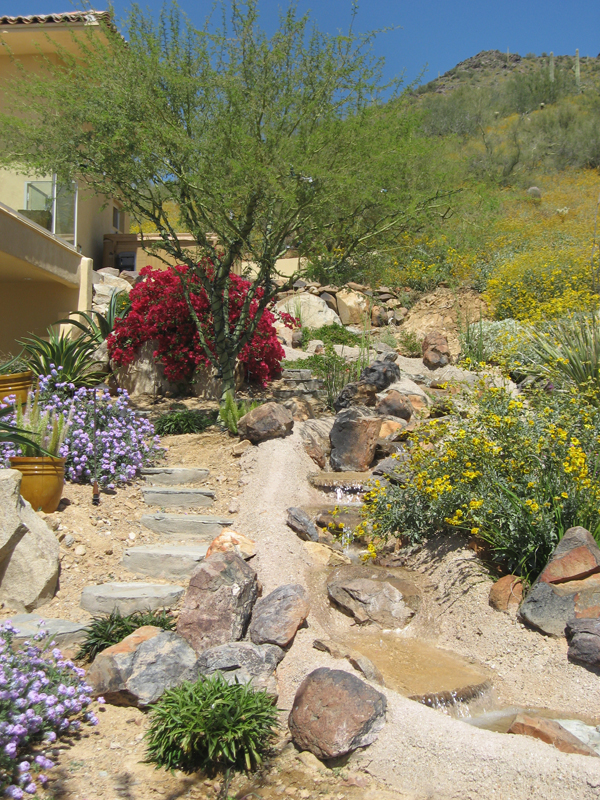 Peaceful water features accent the surrounding landscape; Photo: French Accent Landscaping