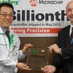 Mr. Hitoshi Tatsuno, Vice President of Operation Management Dept. & Purchasing Dept., Nidec Corporation, receives the 12 billionth PIC® Microcontroller trophy from Joe Krawczyk, Vice President, Sales, Asia Pacific, Microchip Technology Inc.